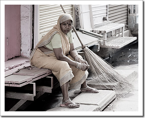 A Street Cleaner Taking a Short Break